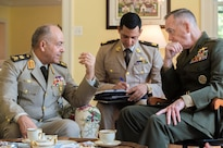Marine Corps Gen. Joe Dunford, right, chairman of the Joint Chiefs of Staff, and Lt. Gen. Mahmoud Hegazy, chief of staff of Egypt's armed forces, talk at Dunford's home at Joint Base Myer-Henderson Hall, Va., May 26, 2016. DoD photo by Army Staff Sgt. Sean K. Harp