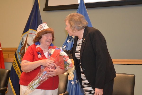 Winifred Woll, keynote speaker during the Memorial Day observation May 26, receives a thank you bouquet from Jackie Baxter, Philadelphia Compound Veterans Committee chairperson. The PCVC organized the ceremony.