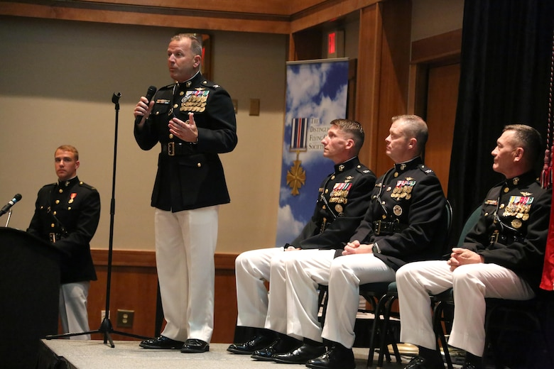 Senior leaders in aviation give opening remarks on stage during a winging ceremony at New Bern, N.C., May 19, 2016. Naval aviators received the prestigious honor of receiving an iconic emblem, depicting the culmination of years of training, perseverance and sacrifice. Pilots and crewmen receive wings once they complete their respective training requirements and are then designated to join the fleet as an operational Marine Corps asset. The winging ceremony took place during the 45th Annual Marine Corps Aviation Association Symposium and Marine Corps Aviation Summit. ( U.S. Marine Corps photo by Cpl. N.W. Huertas/ Released)