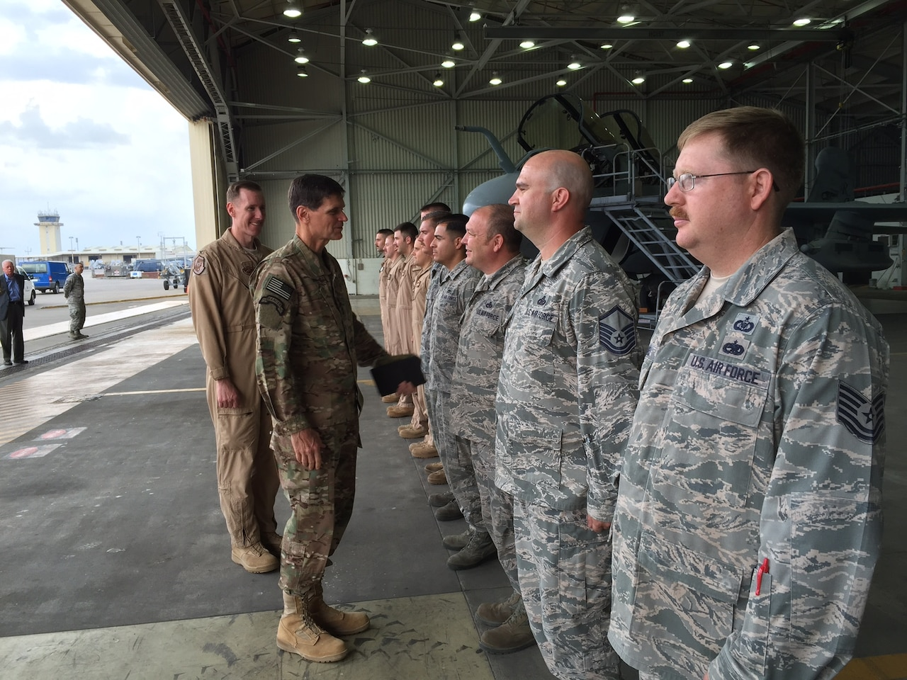 In a hangar off the flightline at Incirlik Air Base in southeastern Turkey, Army Gen. Joseph L. Votel, commander of U.S. Central Command, greets representatives from a Marine Corps EA-6 Prowler Squadron, a KC-135 tanker crew, and several aircraft maintainers, May 23, 2016. Votel was accompanied by 447th Air Expeditionary Group Commander Air Force Col. Sean McCarthy. DoD photo by Cheryl Pellerin