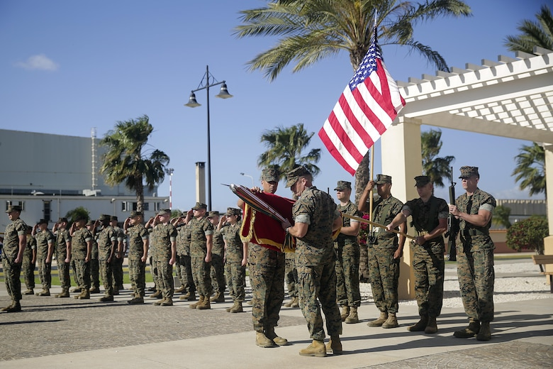 Lt. Col. Matthew Hakola, the Commanding Officer for Combat Logistics Battalion 6, and Sgt. Maj. Dean Orial, the Sergeant Major for CLB-6 prepare to encase the battalion's colors for transfer of authority to CLB-2 at Naval Air Station Sigonella, Italy on April 25, 2016.  Special Purpose Marine Air-Ground Task Force Crisis Response-Africa Logistics Combat Element provides logistical support to the entire SPMAGTF enabling the protection of U.S. personnel, property and interests in Europe and Africa. (U.S. Marine Corps photo by Cpl. Alexander Mitchell/released)