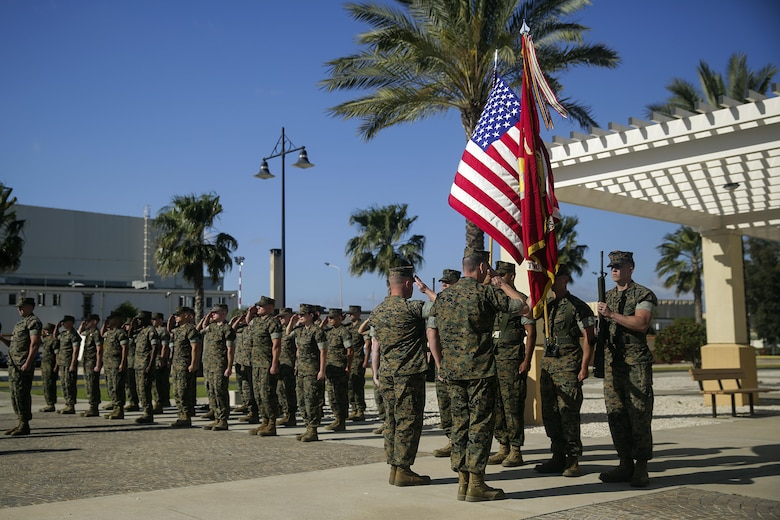 Lt. Col. Randall Jones, the Commanding Officer for Combat Logistics Battalion 2, and Sgt. Maj. Daniel Wilson, the Sergeant Major for CLB-2, render a salute after uncasing the battalion's colors during the transfer of authority ceremony for Special Purpose Marine Air-Ground Task Force Crisis Response-Africa Logistics Combat Element on April 25, 2016 at Naval Air Station Sigonella, Italy.  SPMAGTF-CR-AF LCE provides logistical support to the entire SPMAGTF enabling the protection of U.S. personnel, property and interests in Europe and Africa.  (U.S. Marine Corps photo by Cpl. Alexander Mitchell/released)
