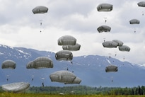Paratroopers descend and land on Malemute drop zone during air transportability training at Joint Base Elmendorf-Richardson, Alaska, May 19, 2016. Air Force photo by Alejandro Pena