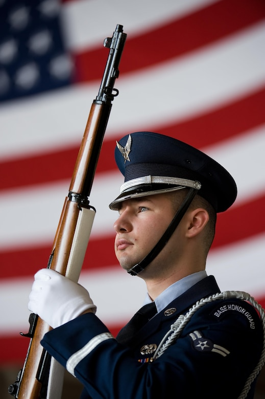 Dover Air Force Base Honor Guard member Airman 1st Class Andrew Des Marias stands at the position of port arms prior to the start of the 436th Maintenance Group change of command ceremony May 24, 2016, on Dover AFB, Del. Des Marias is assigned to the 436th Aerial Port Squadron as a fleet service specialist when not performing honor guard duties. (U.S. Air Force photo/Roland Balik)