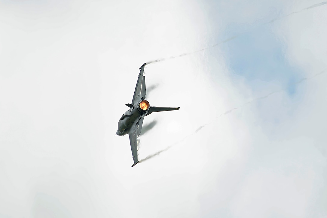 """An F-16 Fighting Falcon performs an aerial demonstration during the Shaw Air Expo and open house, nicknamed the """"Thunder Over the Midlands,"""" at Shaw Air Force Base, S.C., May 21, 2016."""