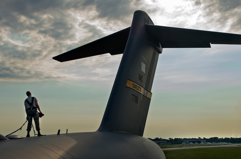 Airman Bradley Williams, a 437th Aerospace Maintenance Squadron crew chief, inspects a C-17 Globemaster III as part of Crescent Reach 16 on May 24, 2016, at Joint Base Charleston, S.C. Crescent Reach is an annual exercise designed to test and evaluate Joint Base Charleston's ability to mobilize and launch a large aircraft formation in addition to train, process and deploy Airmen and cargo in response to a simulated crisis board. (U.S. Air Force photo/Senior Airman Ericka Engblom)