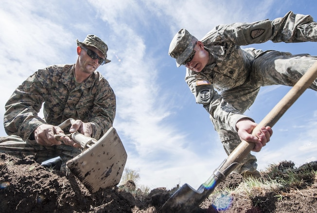 Marine Corps Sgt. Maj. Mike Grunst and Sgt. Robert Morrill dig a hole for a solar still during Khaan Quest 2016 in Ulaan Bataar, Mongolia, May 27, 2016. The exercise is a survival training course for U.S., Mongolian and Czech forces. Navy photo by Petty Officer 3rd Class Markus Castaneda