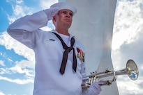 Navy Petty Officer 3rd Class Shelby Tucci, assigned to the Pacific Fleet Band, salutes after playing taps at the USS Arizona Memorial during a National Park Service sunset tour at Joint Base Pearl Harbor-Hickam, Hawaii, May 26, 2014. Navy photo by Petty Officer 1st Class Daniel Barker
