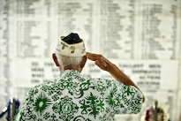 Retired Army Command Sgt. Maj. Sterling R. Cale, a 90-year-old Pearl Harbor survivor, takes a moment in the shrine room of the USS Arizona Memorial at Joint Base Pearl Harbor-Hickam, Hawaii, May 27, 2012, during a ceremony to honor the 1,177 service members who lost their lives during the attack on the USS Arizona on Dec. 7, 1941. U.S. Air Force photo by Tech. Sgt. Michael Holzworth