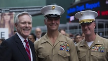 Secretary of the Navy Ray Mabus poses for a photo with a Col. Ryan Rideout, commanding officer, 24th Marine Expeditionary Unit, and Sgt. Maj. Douglas Cutsail III, sergeant major, 24th MEU, during Fleet Week New York in Times Square, May 26, 2016. The Marines and sailors are visiting the city to interact with the public, demonstrate capabilities and teach the people of New York about America's maritime services.