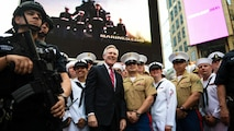 The U.S. Secretary of the Navy Ray Mabus poses for a photo with a group of Marines and Sailors during Fleet Week New York in Times Square, May 26, 2016. The Marines and Sailors visited the city to interact with the public, demonstrate capabilities and teach the people of New York about America's sea services.