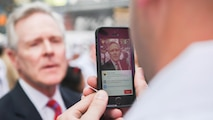 Secretary of the Navy Ray Mabus gives a motivational speech to Marines and sailors through Periscope during Fleet Week New York in Times Square, May 26, 2016. The Marines and sailors are visiting the city to interact with the public, demonstrate capabilities and teach the people of New York about America's sea services.