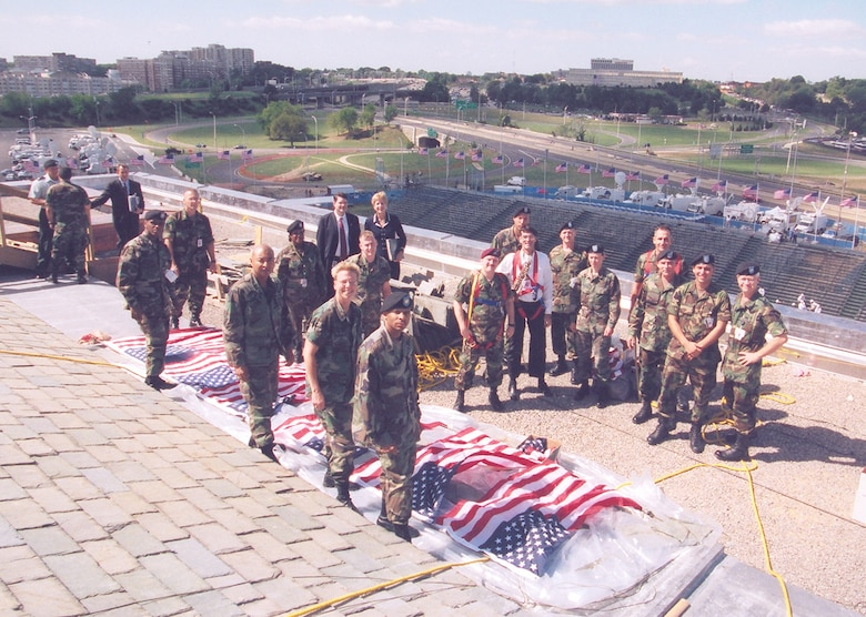 Service members display American flags at the Pentagon in Washington, D.C., for a 9/11 observance in 2002. (Courtesy photo)