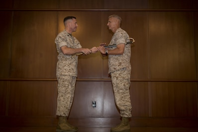 Sgt. Maj. Anthony A. Spadaro, former Marine Forces Reserve and Marine Forces North sergeant major, passes the Noncommissioned Officer sword to Lt. Gen. Rex C. McMillian, commander of Marine Forces Reserve and Marine Forces North during the Relief and Appointment ceremony at Marine Corps Support Facility New Orleans, May 27, 2016. Spadaro, who has been selected to serve as the senior enlisted advisor for U.S. Pacific Command, passes on his duties to Sgt. Maj. Patrick L. Kimble, former sergeant major of 3rd Marine Aircraft Wing.