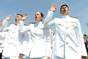 Midshipmen are commissioned as Navy ensigns at the graduation and commissioning at the U.S. Naval Academy in Annapolis, Maryland, May 27, 2016. Navy photo