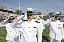 Midshipmen salute at the graduation and commissioning at the U.S. Naval Academy in Annapolis, Maryland, May 27, 2016. Navy photo
