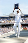 A newly commissioned officer celebrates during the graduation and commissioning at the U.S. Naval Academy in Annapolis, Maryland, May 27, 2016. Navy photo