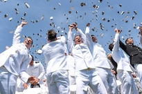 Graduates of the U.S. Naval Academy toss their hats after their commencement ceremony in Annapolis, Md., May 27, 2016. Defense Secretary Ash Carter provided remarks during the event. DoD photo by Army Sgt. 1st Class Clydell Kinchen