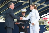 Defense Secretary Ash Carter congratulates a graduate during the commencement ceremony at the U.S. Naval Academy in Annapolis, Md., May 27, 2016. DoD photo by Army Sgt. 1st Class Clydell Kinchen