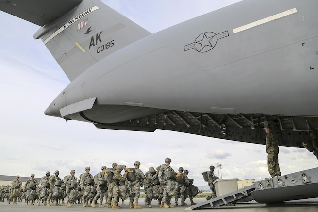 Paratroopers board an Air Force C-17 Globemaster III aircraft before participating in air transportability training at Joint Base Elmendorf-Richardson, Alaska, May 19, 2016. The aircraft crew is assigned to the 517th Airlift Squadron. Air Force photo by Alejandro Pena