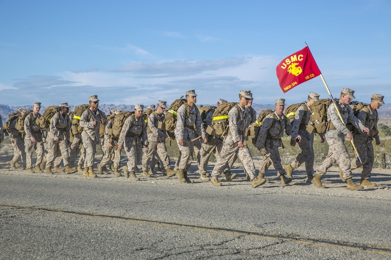 Marines with Marine Wing Support Squadron 374 trek during a 15 km hike from the squadron's headquarters building to Camp Wilson May 6, 2016. This was the last hike MWSS-374 conducted with their current sergeant major and commanding officer. (Official Marine Corps photos by Lance Cpl. Dave Flores/Released)