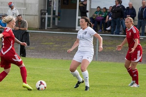 Marine Corps 1st Lt. Brittany Fruin of Camp Lejeune, NC passes the ball against Germany in their opening match of the 2016 Conseil International du Sport Militaire (CISM) World Women's Football Cup in Rennes, France 24 May to 6 June.