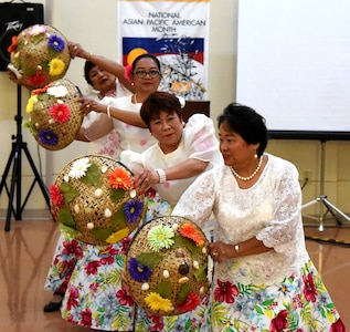 Dancers of the Filipino-American Association of Greater Columbia, SC, perform a traditional Filipino dance during an Asian/Pacific American Heritage Month celebration May 24, 2016 at Naval Health Clinic Charleston. (Navy photo/Hospitalman 3rd Class Robert Jackson)