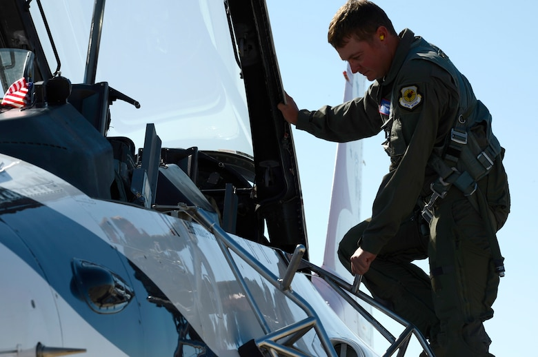 Tyrell Gonser, Clovis Hometown Hero, steps into the backseat of an F-16, in preparation for a flight with the U.S. Air Force Thunderbirds May 27, 2016, at Cannon Air Force Base, N.M. The 2016 CAFB Air Show is an opportunity to celebrate the long-standing relationship between the 27th Special Operations Wing and the High Plains community. (U.S. Air Force photo/Tech. Sgt. Manuel Martinez)