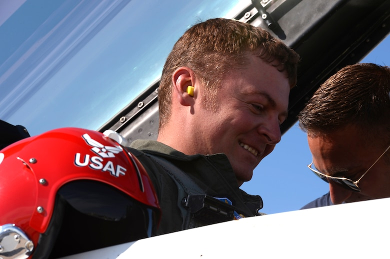 Tyrell Gonser, Clovis Hometown Hero, gets secured in the backseat of an F-16, in preparation for a flight with the U.S. Air Force Thunderbirds May 27, 2016, at Cannon Air Force Base, N.M. The 2016 CAFB Air Show is an opportunity to celebrate the long-standing relationship between the 27th Special Operations Wing and the High Plains community. (U.S. Air Force photo/Tech. Sgt. Manuel Martinez)