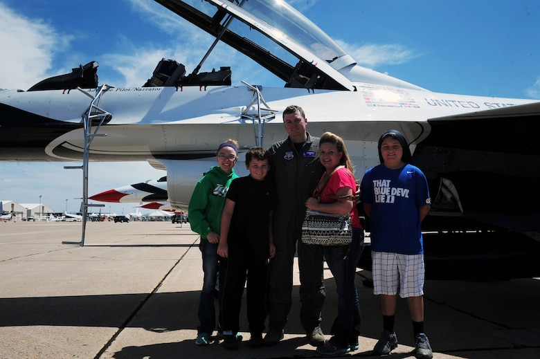 Tyrell Gonser and his family pose for a photo after his Hometown Hero flight with the U.S. Air Force Thunderbirds May 27, 2016, at Cannon Air Force Base, N.M. The 2016 CAFB Air Show is an opportunity to celebrate the long-standing relationship between the 27th Special Operations Wing and the High Plains community. (U.S. Air Force photo/Tech. Sgt. Manuel Martinez)