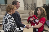 Defense Secretary Ash Carter and his wife, Stephanie, greet people arriving at the Pentagon as part of a seminar and youth camp held annually by the Tragedy Assistance Program for Survivors, or TAPS, May 27, 2016. TAPS supports families who have lost a military member. DoD photo by Senior Master Sgt. Adrian Cadiz