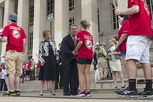 Defense Secretary Ash Carter greets a young guest as he and his wife, Stephanie, welcome members of the Tragedy Assistance Program for Survivors, or TAPS, to the Pentagon, May 27, 2016, for a night of fun and remembrance to coincide with Memorial Day weekend. DoD photo by Air Force Senior Master Sgt. Adrian Cadiz