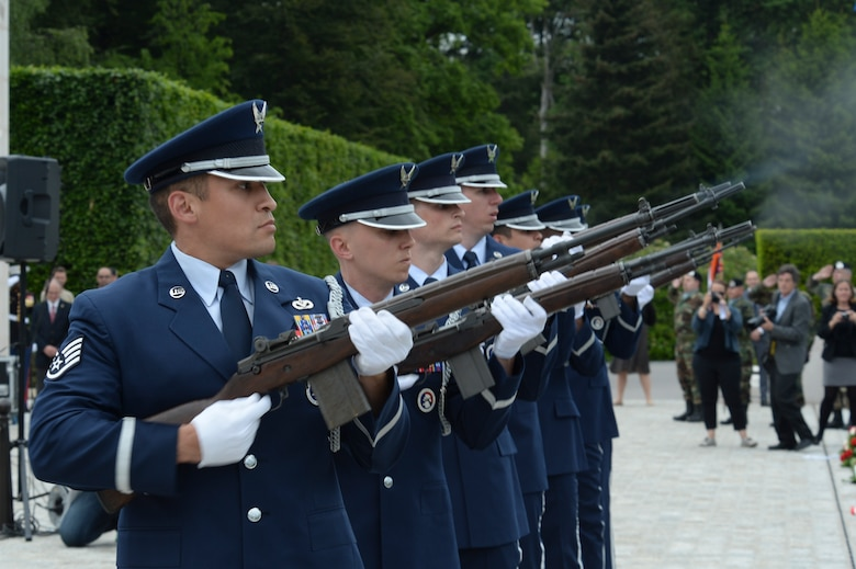 A U.S. Air Force Honor Guard detail from Spangdahlem Air Base, Germany, conducts a ceremonial volley as part of a Memorial Day ceremony at the Luxembourg American Cemetery and Memorial in Luxembourg, May 28, 2016. The base's Airmen also served as a ceremonial flight in service dress, caretakers of the cemetery's Luxembourg and U.S. flags, and escorts for guests to lay wreaths. (U.S. Air Force photo by Staff Sgt. Joe W. McFadden/Released)