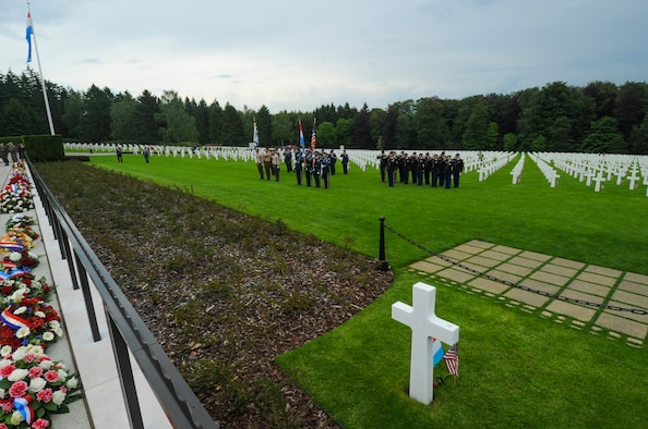 Luxembourg Army Color Guard, U.S. Air Force Airmen assigned to the 52nd Fighter Wing, Spangdahlem Air Base, Germany, and U.S. Army Soldiers assigned to 18th Military Police Brigade, Grafenwoehr, Germany, salute during a Memorial Day ceremony at the Luxembourg American Cemetery and Memorial in Luxembourg, May 28, 2016. The holiday serves as an opportunity to pause and remember the sacrifices of more than one million Soldiers, Sailors, Airmen, Marines and Coast Guardsmen who gave their lives in defense of freedom.   (U.S. Air Force photo by Staff Sgt. Joe W. McFadden/Released)