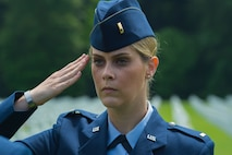 U.S. Air Force 2nd Lt. Melanie Gruenbaum, 52nd Mission Support Group executive officer, salutes as part of a ceremonial flight before a Memorial Day ceremony at the Luxembourg American Cemetery and Memorial in Luxembourg, May 28, 2016. Airmen from Spangdahlem Air Base, Germany, served as a ceremonial flight in service dress, caretakers of the cemetery's Luxembourg and U.S. flags, and escorts for guests to lay wreaths. (U.S. Air Force photo by Staff Sgt. Joe W. McFadden/Released)