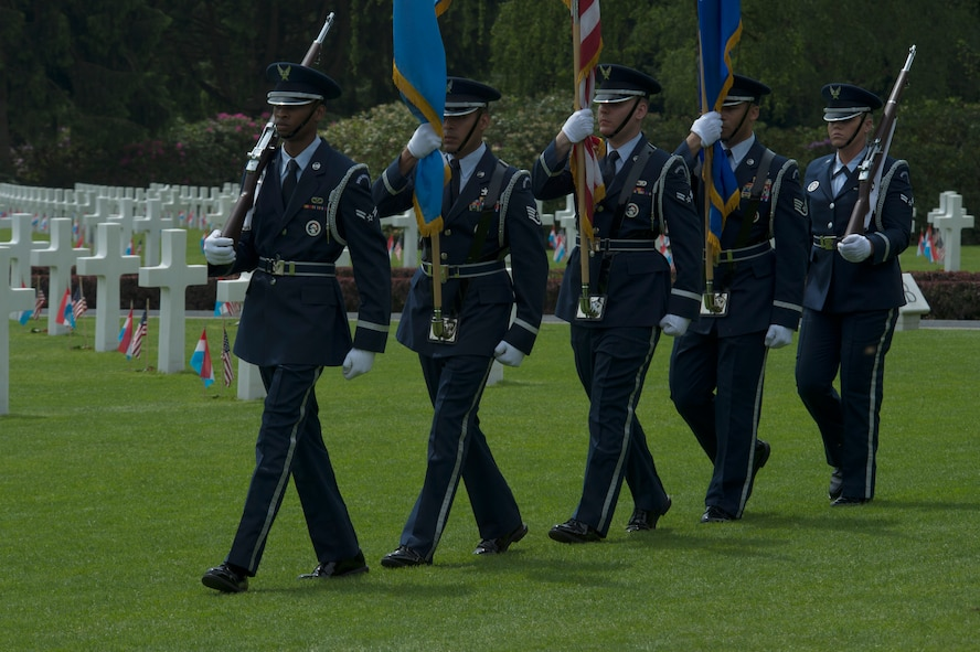 U.S. Air Force ceremonial guardsmen from Spangdahlem Air Base, Germany, carry the colors at the beginning of a Memorial Day ceremony at the Luxembourg American Cemetery and Memorial in Luxembourg, May 28, 2016. Memorial Day is observed on the last Monday of May in remembrance of those who gave the ultimate sacrifice. (U.S. Air Force photo by Staff Sgt. Joe W. McFadden/Released)