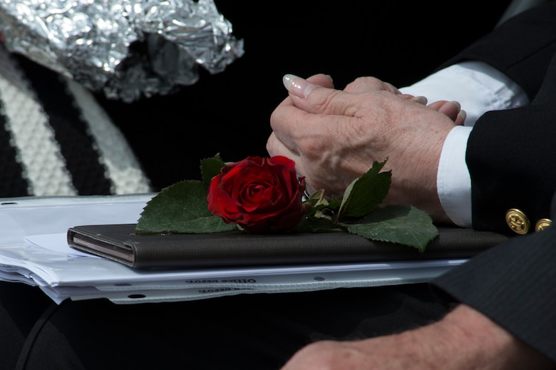 """A rose is displayed on a folder belonging to Marilynn Rustand Lieurance, daughter of U.S. Army Air Corps 1st Lt. Hanford """"Rusty"""" J. Rustand, a B-17 bomber pilot killed in World War II, during a Memorial Day ceremony at the Luxembourg American Cemetery and Memorial in Luxembourg, May 28, 2016. Rustand died when his B-17 came under enemy fire during a mission near Merseburg, Germany, and crashed on Nov. 2, 1944, nearly half a year before Lieurance was born. (U.S. Air Force photo by Staff Sgt. Joe W. McFadden/Released)"""