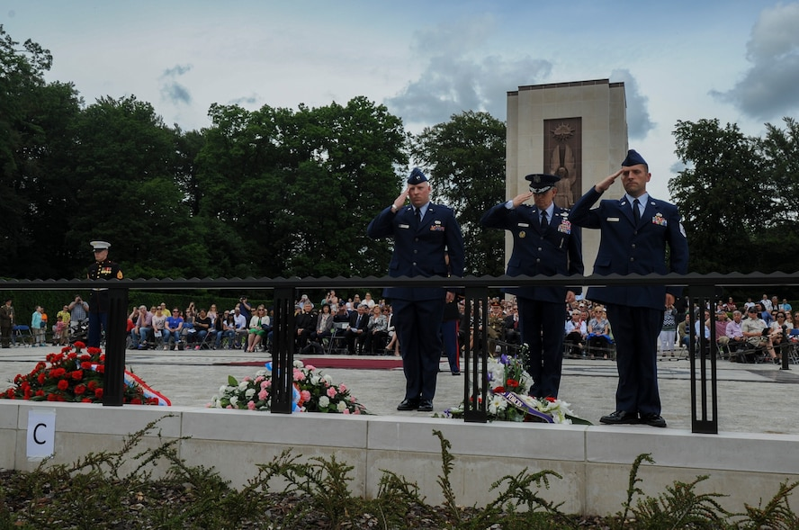 U.S. Air Force Lt. Gen. Timothy Ray, 3rd Air Force and 17th Expeditionary Air Force commander, center, salutes a wreath during a Memorial Day ceremony at the Luxembourg American Cemetery and Memorial in Luxembourg, May 28, 2016. More than 200 Luxembourgers and Americans gathered at the cemetery to reflect on the sacrifices made by fallen U.S. service members. (U.S. Air Force photo by Staff Sgt. Joe W. McFadden/Released)