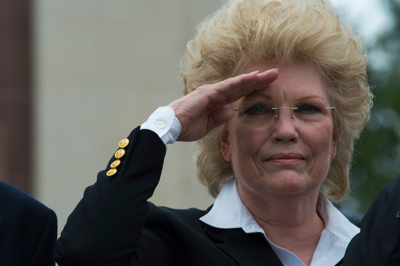 """Marilynn Rustand Lieurance, daughter of U.S. Army Air Corps 1st Lt. Hanford """"Rusty"""" J. Rustand, a B-17 bomber pilot killed in World War II, salutes after laying a wreath during a Memorial Day ceremony at the Luxembourg American Cemetery and Memorial in Luxembourg, May 28, 2016. Rustand died when his B-17 came under enemy fire during a mission near Merseburg, Germany, and crashed on Nov. 2, 1944, nearly half a year before Lieurance was born. (U.S. Air Force photo by Staff Sgt. Joe W. McFadden/Released)"""