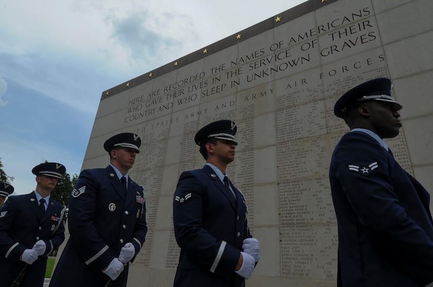A U.S. Air Force Honor Guard detail from Spangdahlem Air Base, Germany, stands ready to be called to conduct a ceremonial volley as part of a Memorial Day ceremony at the Luxembourg American Cemetery and Memorial in Luxembourg, May 28, 2016. The holiday serves as an opportunity to pause and remember the sacrifices of more than one million Soldiers, Sailors, Airmen, Marines and Coast Guardsmen who gave their lives in defense of freedom.  (U.S. Air Force photo by Staff Sgt. Joe W. McFadden/Released)