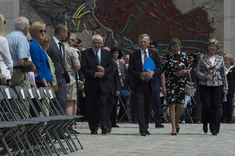 (From center left to right) Lucien Weiler, marshall of the Luxembourg Court, David McKean, U.S. Ambassador to Luxembourg, Lydie Polfer, mayor of Luxembourg city, and Simone Beissel, vice president of the Luxembourg Chamber of Deputies, walk to their seats as members of the official party during a Memorial Day ceremony at the Luxembourg American Cemetery and Memorial in Luxembourg, May 28, 2016. More than 200 Luxembourgers and Americans gathered at the cemetery to reflect on the sacrifices made by fallen U.S. service members.  (U.S. Air Force photo by Staff Sgt. Joe W. McFadden/Released)