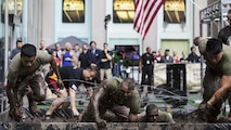 Marines with the 24th Marine Expeditionary Unit compete in an obstacle course during the Fox and Friends Weekend news program, May 28, 2016. U.S. Marines and sailors are in New York for Fleet Week to interact with the public, demonstrate capabilities and teach the people of New York about America's sea services. U.S. Marines and sailors are in New York to interact with the public, demonstrate capabilities and teach the people of New York about America's sea services.