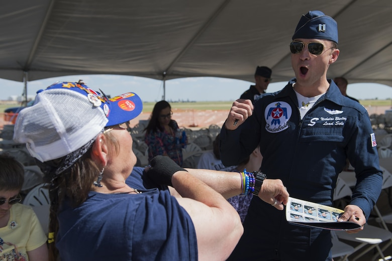 U.S. Air Force Thunderbirds pilots and crew members meet with special guests from ENMRSH, an organization that helps those with physical or intellectual limitations, after a Thunderbirds rehearsal show May 27, 2016, at Cannon Air Force Base, N.M. The 2016 CAFB Air Show is an opportunity to celebrate the long-standing relationship between the 27th Special Operations Wing and the High Plains community. (U.S. Air Force photo/Airman 1st Class Kai White)