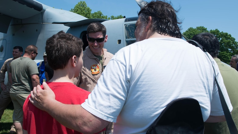 Capt. Ben Price, the current operations officer with Marine Medium Tiltrotor Squadron 261, speaks with New Yorkers about the MV-22 Osprey during Military Day as part of Fleet Week at Eisenhower Park in East Meadow, New York, May 28, 2016. The Marines and sailors are visiting to interact with the public, demonstrate capabilities and teach the people of New York about America's sea services.