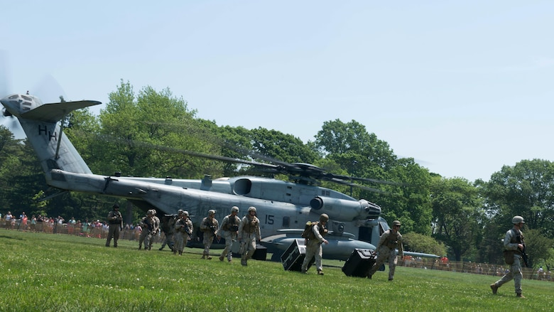 Marines with the 24th Marine Expeditionary Unit arrive from a CH-53E Super Stallion during Military Day as part of Fleet Week at Eisenhower Park in East Meadow, New York, May 28, 2016. The Marines and sailors are visiting to interact with the public, demonstrate capabilities and teach the people of New York about America's sea services.