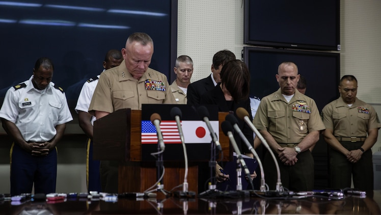 Lt. Gen. Lawrence D. Nicholson holds a moment of silence as he announces a 30-day period of unity and mourning for all U.S. military and Status of Forces Agreement personnel on Okinawa, at a press conference on Camp Foster, Okinawa, Japan, May 28, 2016. Out of respect for the people of Okinawa, Nicholson chose to demonstrate the solidarity of the U.S. service members here and the people of Okinawa by honoring the recent loss of an Okinawan female. The period of unity and mourning was directed to all U.S. military, and Nicholson also highly encouraged all SOFA-status members to partake, as this period will serve as a time to reflect on personal conduct, to consider their roles as ambassadors to Japan, and demonstrate the deepest sympathies for the victim and her family. Nicholson, from Toronto, Canada, is the Okinawa Area Coordinator and commanding general for III Marine Expeditionary Force. (U.S. Marine Corps photo by Lance Cpl. Jessica N. Etheridge/Released)