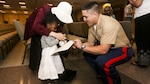 2nd Lt. Marc Martinez, a platoon commander with 3rd Battalion, 6th Marine Regiment, helps a girl complete an ice breaking exercise during an effort to bring aid and support to children in need at Times Square Church in New York, May 28, 2016. Fleet Week New York is an opportunity for the public to interact with service members from America's sea services, spreading awareness of the Navy and Marine Corps' missions at home and abroad.