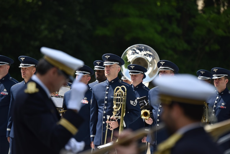 PARIS – Airmen from the U.S. Air Forces in Europe Band stand at attention as a French military band plays ceremonial music during a Memorial Day ceremony at the Lafayette Escadrille Memorial, in Marnes-la-Coquette, France, May 28, 2016. During the ceremony, French and American speakers honored the shared sacrifices of U.S. and French service members fighting for each other's freedom and security in a relationship that began more than 240 years ago during the American Revolutionary War. (U.S. Air Force photo by Senior Master Sgt. Brian Bahret/Released)