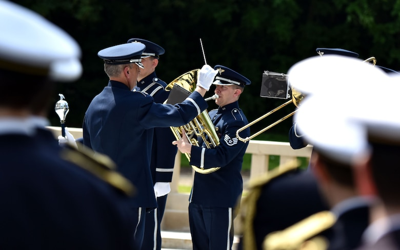 PARIS – A French ceremonial band watches, as U.S. Air Force Lt. Col. Michael Minch, U.S. Air Forces in Europe Band commander, and the USAFE Band play ceremonial music during a Memorial Day ceremony at the Lafayette Escadrille Memorial, in Marnes-la-Coquette, France, May 28, 2016. During the ceremony, French and American speakers honored the shared sacrifices of U.S. and French service members fighting for each other's freedom and security in a relationship that began more than 240 years ago during the American Revolutionary War. (U.S. Air Force photo by Senior Master Sgt. Brian Bahret/Released)