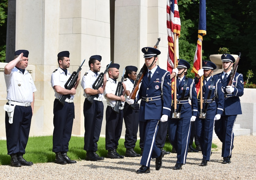 PARIS – A French Honor Guard salutes as U.S. Air Force Airmen from Ramstein Air Base, Germany, post the colors during a Memorial Day ceremony at the Lafayette Escadrille Memorial, in Marnes-la-Coquette, France, May 28, 2016. During the ceremony, French and American speakers honored the shared sacrifices of U.S. and French service members fighting for each other's freedom and security in a relationship that began more than 240 years ago during the American Revolutionary War. (U.S. Air Force photo by Senior Master Sgt. Brian Bahret/Released)